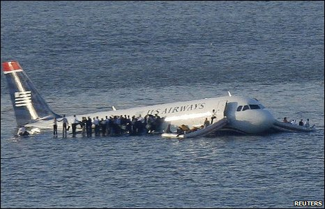 Passengers stand on the wings of the Hudson crash plane